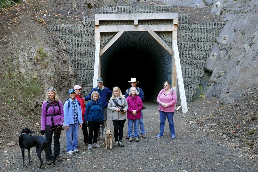 The hikers about to go into the newly reopened tunnel