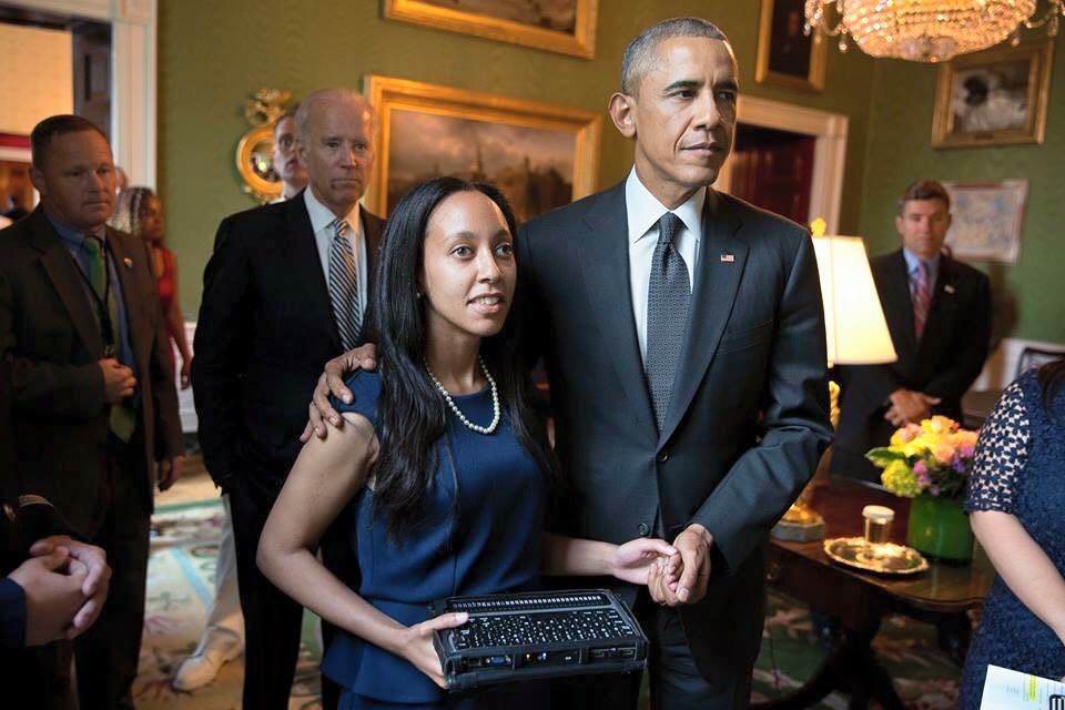 Client Attorney Haben Girma with President Barack Obama in front of Vice President Joe Biden
