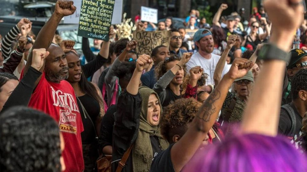 Protesters chant during a Day of Action protest in downtown Sacramento hosted by Black Lives Matter Sacramento and the Anti Police-Terror Project in Sacramento, Calif., on Wed., April 4, 2018. The demonstrators are seeking justice for Stephon Clark, who was killed by Sacramento police in his grandmother's backyard.   Renee C. Byer rbyer@sacbee.com