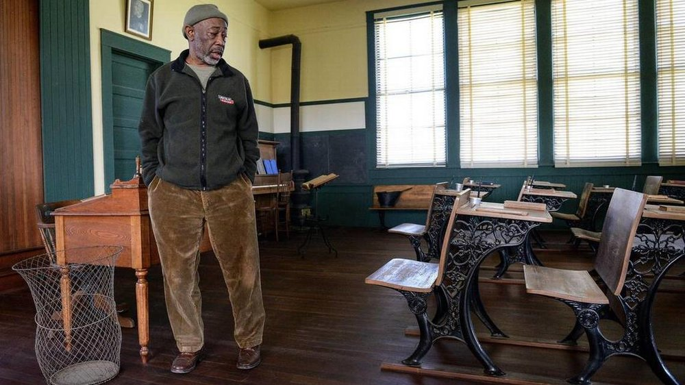 Friends of Allensworth docent Emmett Harden in the classroom of the original Allensworth schoolhouse built in 1912 at Colonel Allensworth State Historic Park near Earlimart on Thursday, Feb. 7, 2019.  CRAIG KOHLRUSS   FRESNO BEE FILE