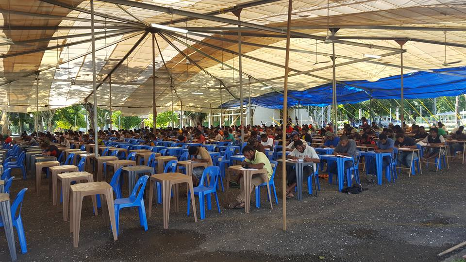 Students sit exams in a tent