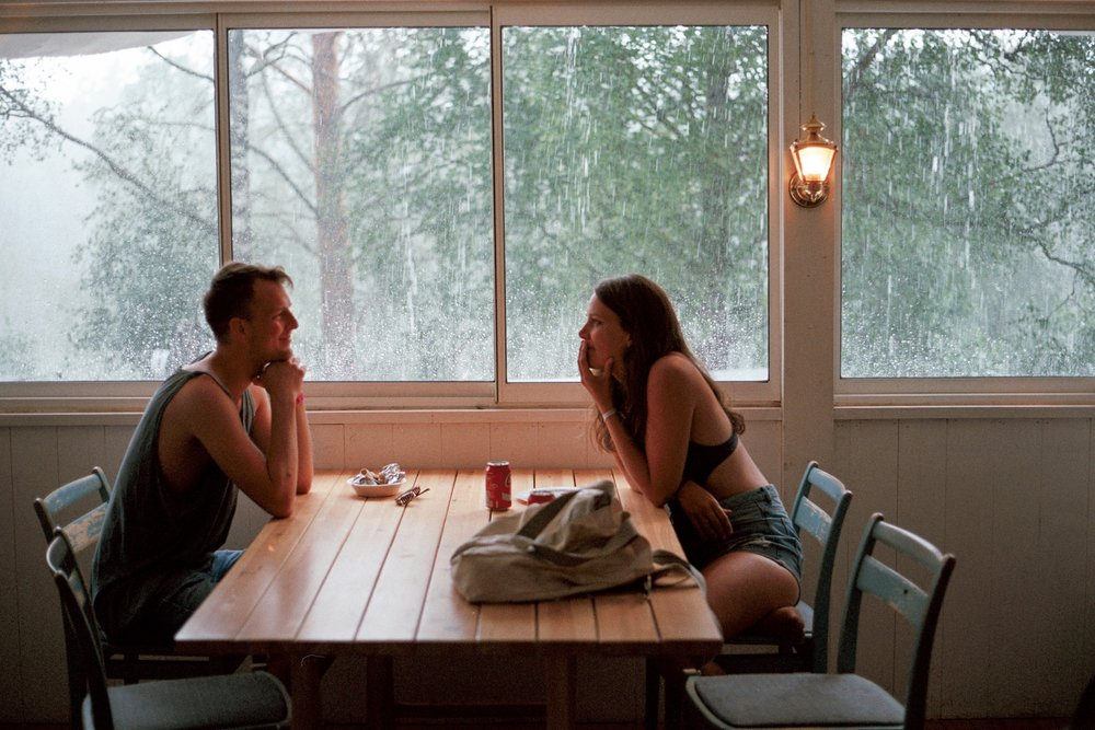couple at wooden table, couples counseling columbia mo