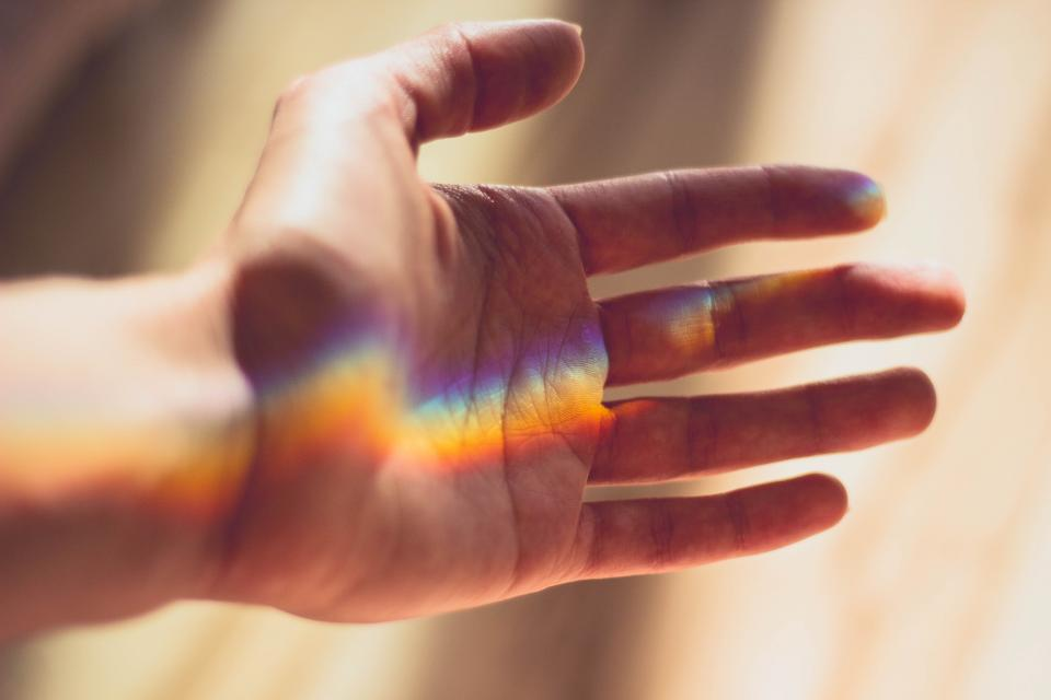 hand with reflection, hand with rainbow, lgbtq rainbow