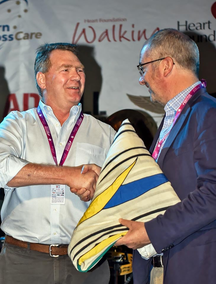 Receiving-Australian-Masters-Games-Flag-from-the-South-Australian-Minister-for-Tourism,-Sport-&-Recreation-the-Hon.jpg