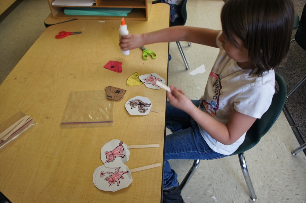We make puppets to help retell familiar stories.