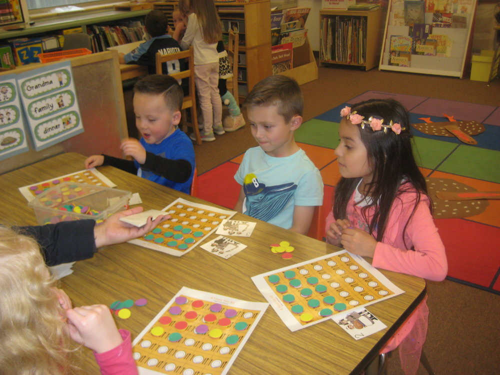 "Playing a game from our Thanksgiving Unit, ""A Feast for All!"""