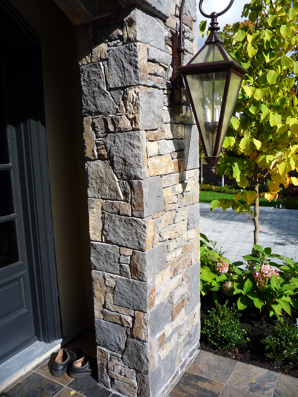Basalt exterior entry with custom corners, Shaughnessy
