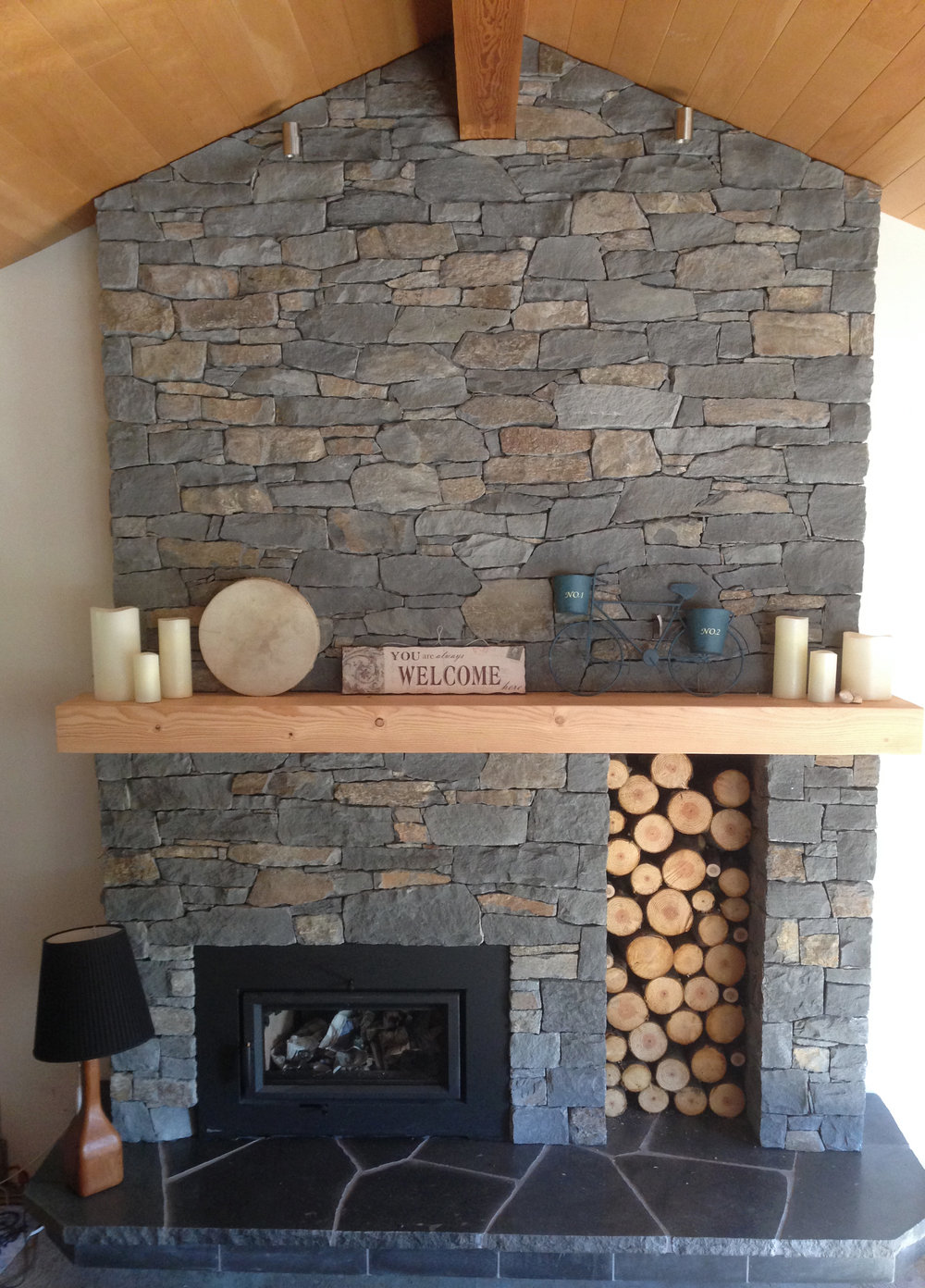 Basalt fireplace surround with Douglas fir mantel and polished basalt slab hearth