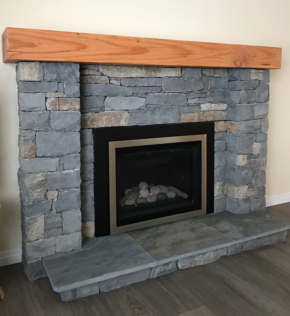 Fireplace renovation - replaced aging brick with new materials, basalt and fir