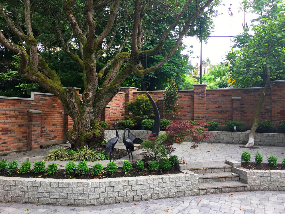 Arbutus Greenway heritage brick enclosure - courtyard