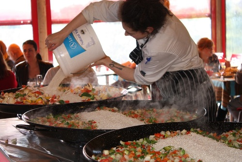 Head Chef Courtney Websdale Pours the rice into the Paella