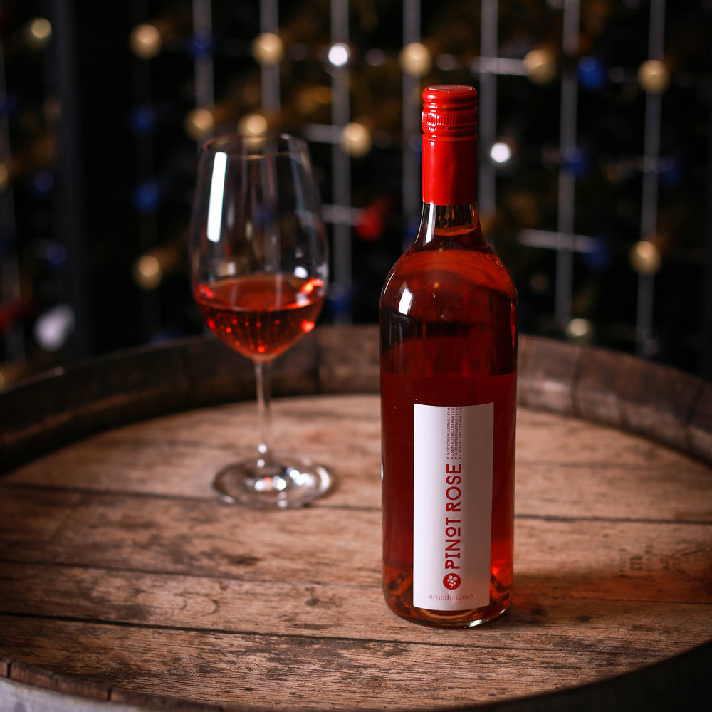 PINOT ROSE - Subtle nose with strawberry and cherry. Characters lead into a generous palate of fresh ripe red fruits and rhubard notes. Firm acid takes the wine through to a vibrant, dry conclusion.