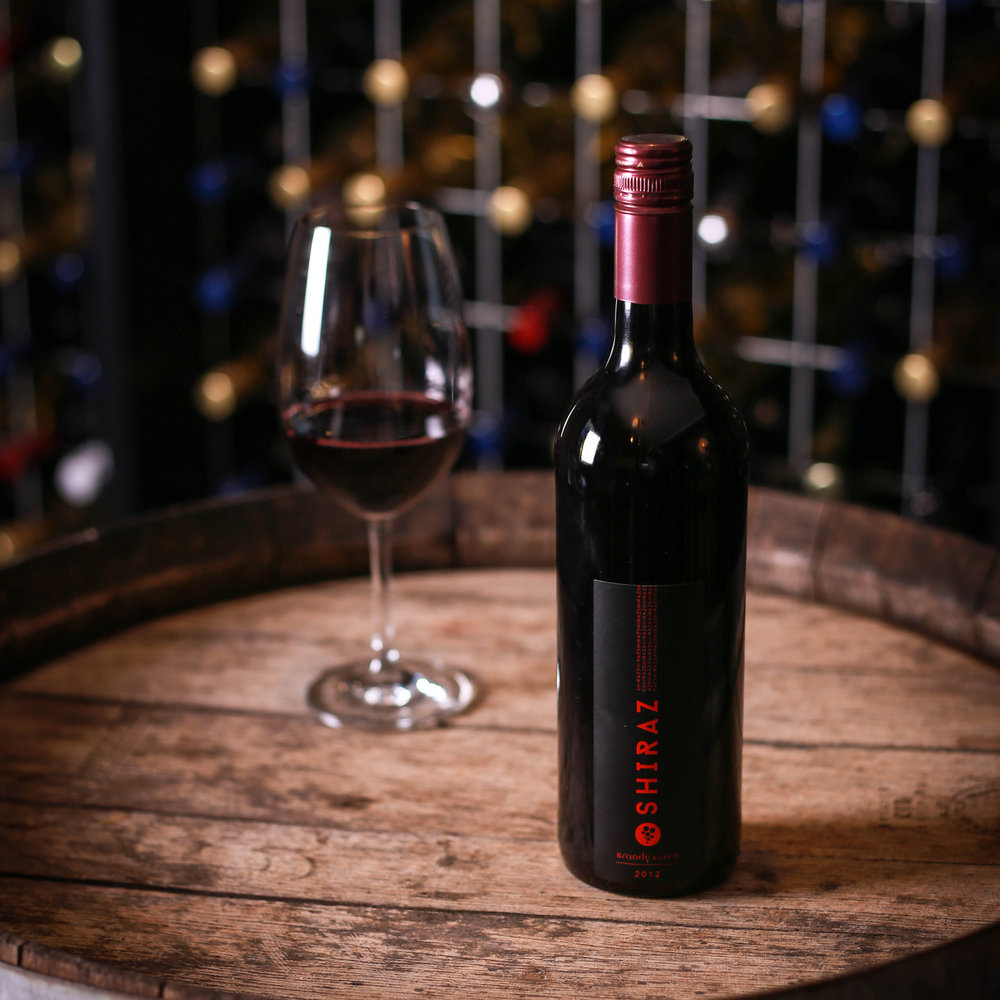 SHIRAZ - A stunning example of a cool climate Shiraz. This is all brawn and muscle. A big, ripe powerful nose leads into a mouth filling palate complete with blackberry, plums, pepper and oak characters. The long lingering finish gives you plenty of joy long after the wine leaves your palate.