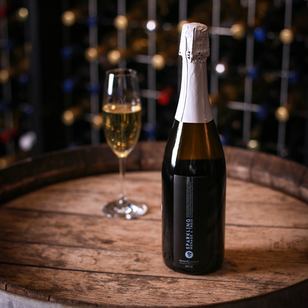 SPARKLING MENAGE A TROIS - Made from traditional champagne varieties - Chardonnay, Pinot Noir & Pinot Munier. Long maturation period of this wine has produced a delicate wine with depth and complexity through the palate, with aromatic reminiscent of brioche and camembert cheese.