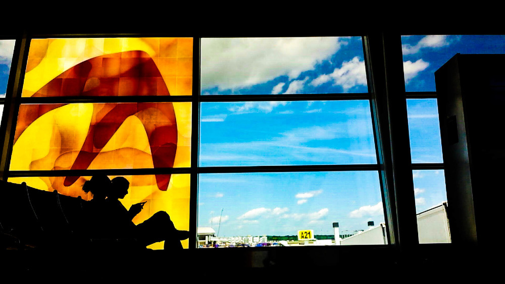 Travelers wait for their flight at the Indianapolis International Airport.