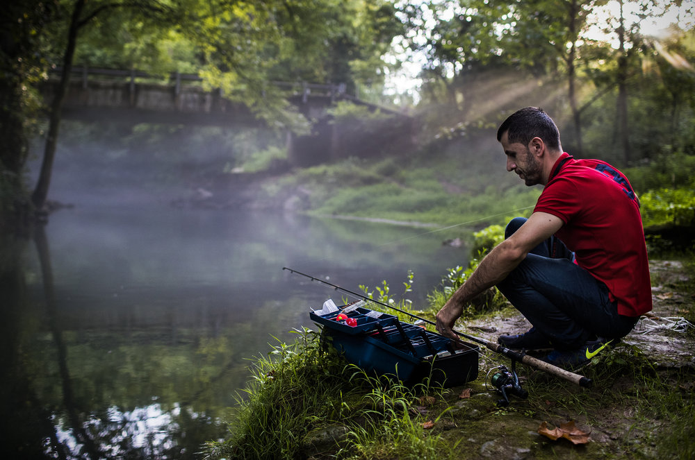 Frank Akhmedov of Bowling Green fishes for trout in a freshly stocked stream on Wednesday, Aug. 16, 2017, at Jennings Creek in Bowling Green.