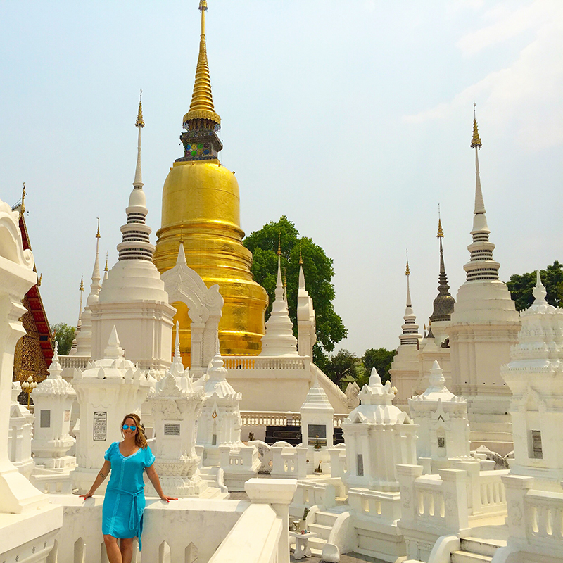 Beautiful gold and white Chedis at the Wat Suan Dok Temple