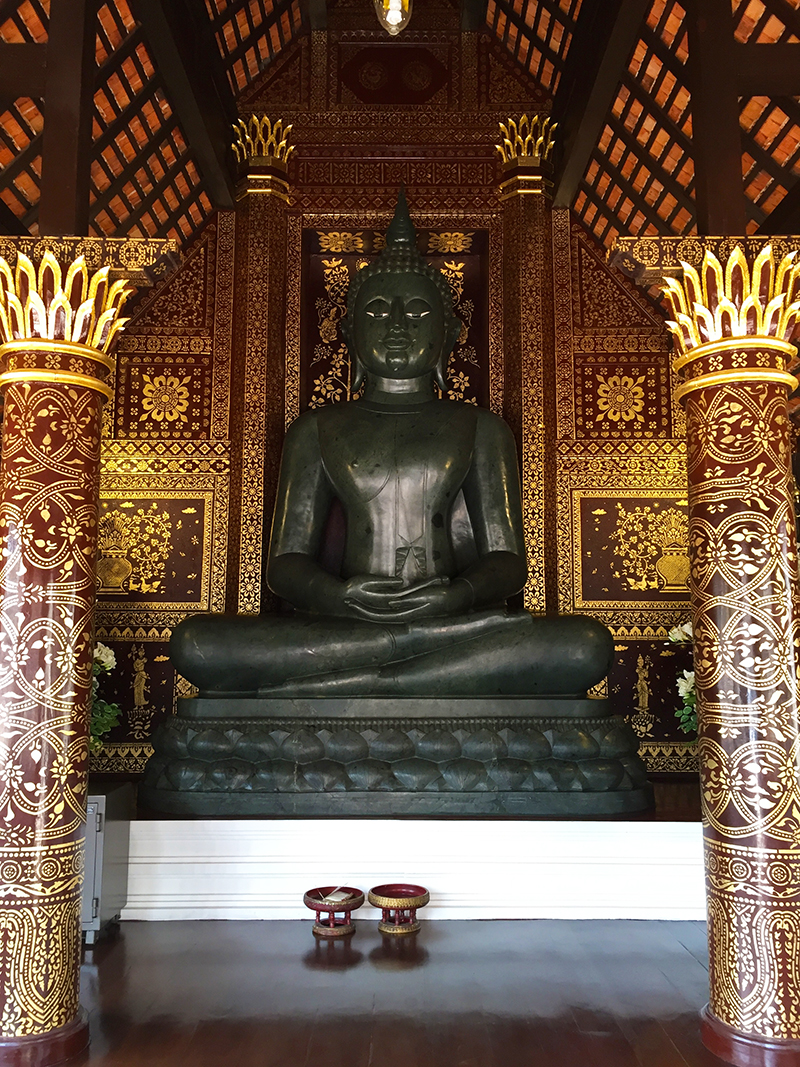 Black stone Buddha figure at the Wat Phra Singh