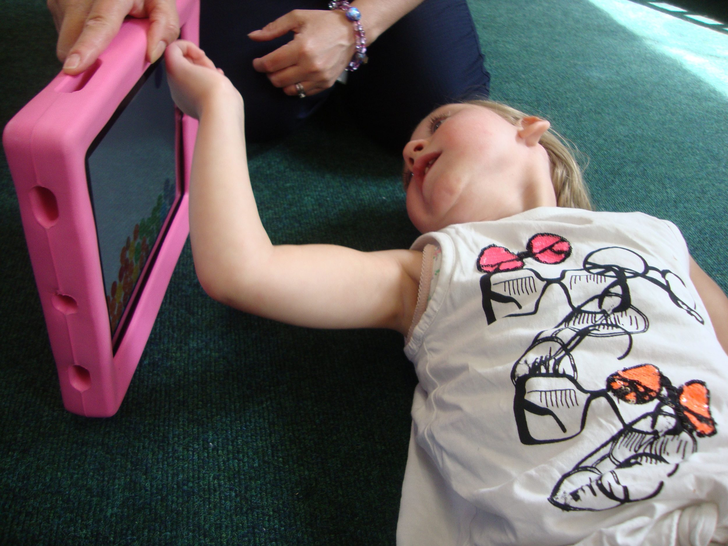 One of the children at Hadrian School plays with their iPad