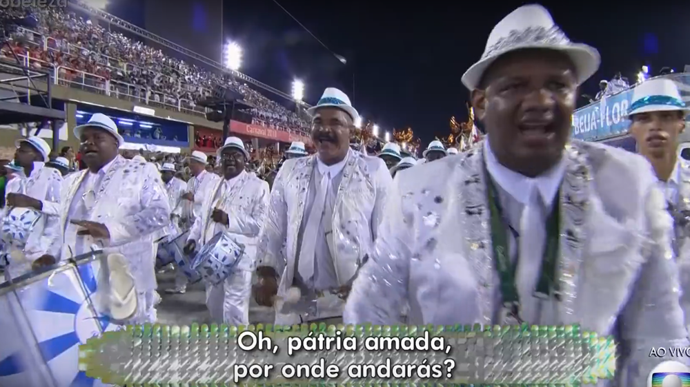 "Members of the Beija-Flor samba school sing: ""O beloved home land, where will you end up? Your children can't take it anymore!"" The full parade can be seen  here."