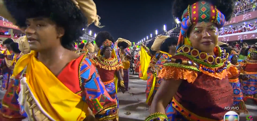 Women in African costumes to represent Brazil's cultural and racial diversity.