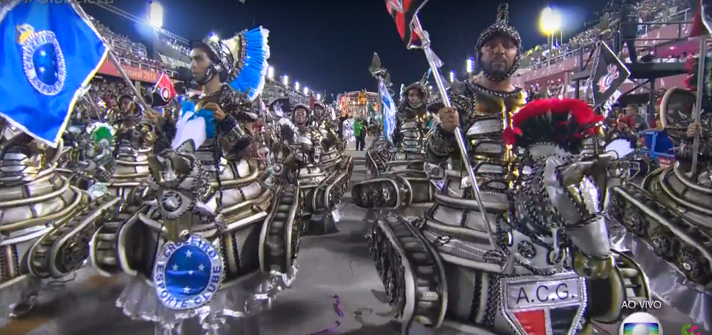 Fans from various sports teams dressed as if for battle, in armor, representing the violence that often breaks out between supporters of rival football teams.