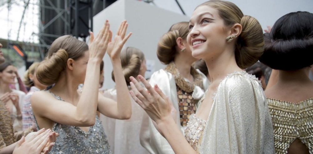 Gigi Hadid backstage at Chanel Haute Couture S/S 16.  Photograph by Kevin Tachman, source: Vogue