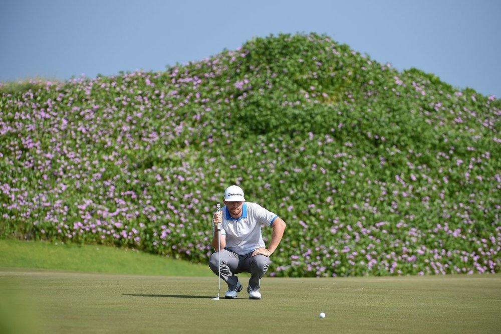 Garrick (Gaz) lining up a putt in Oman...