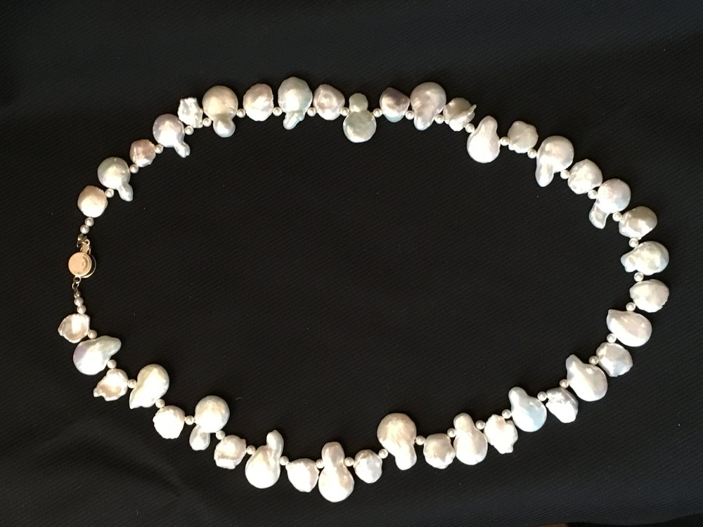 Necklace with white, raw fresh water pearls