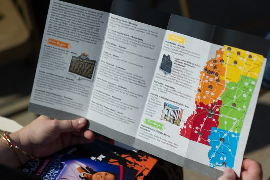 An attendee looks at a brochure illustrating the locations of more than 30 Freedom Trail markers.