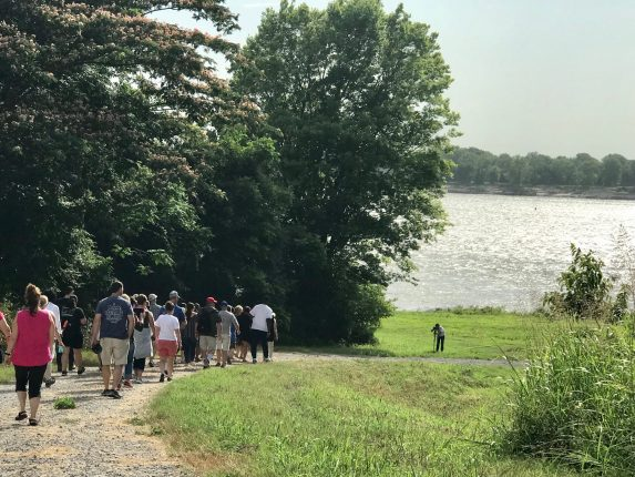 NEH Most Southern Institute participants walk to the Mississippi River at the historic Flood of 1927 levee break site.