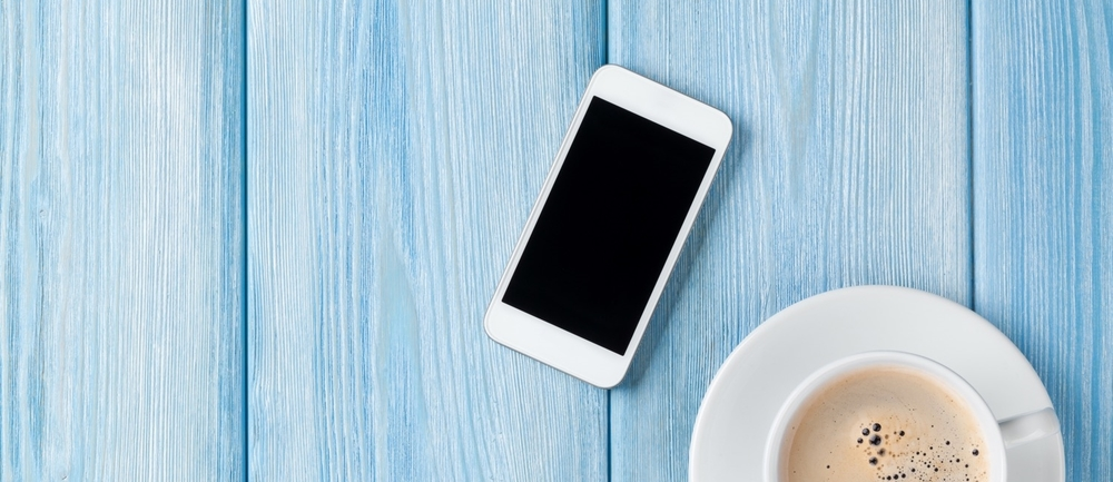 Coffee cup and phone on blue (1).jpg