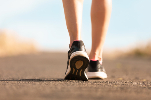 Woman wearing sneakers, trainers and walking for exercise