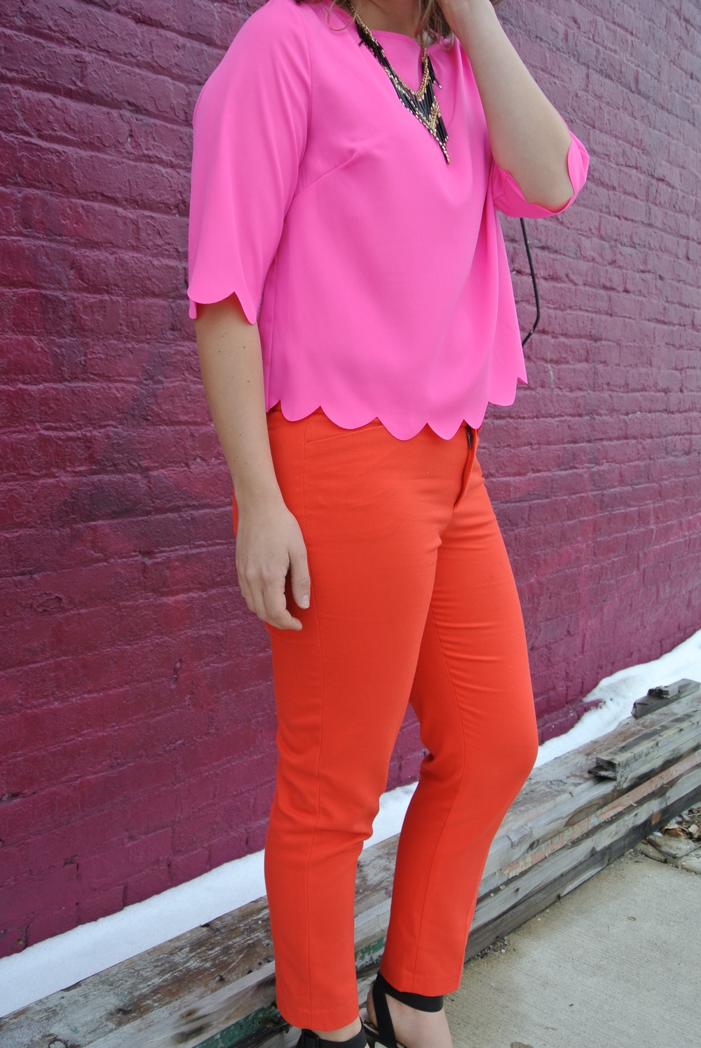 hot pink and red pants outfit