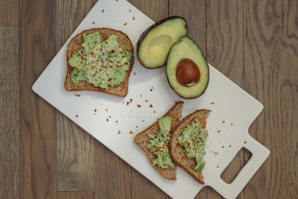 avocado toast, avocados, red pepper confetti, avocado toast with red pepper confetti, how to make avocado toast, olive oil, garlic powder, parmigiano-reggiano cheese, healthy breakfast choices,