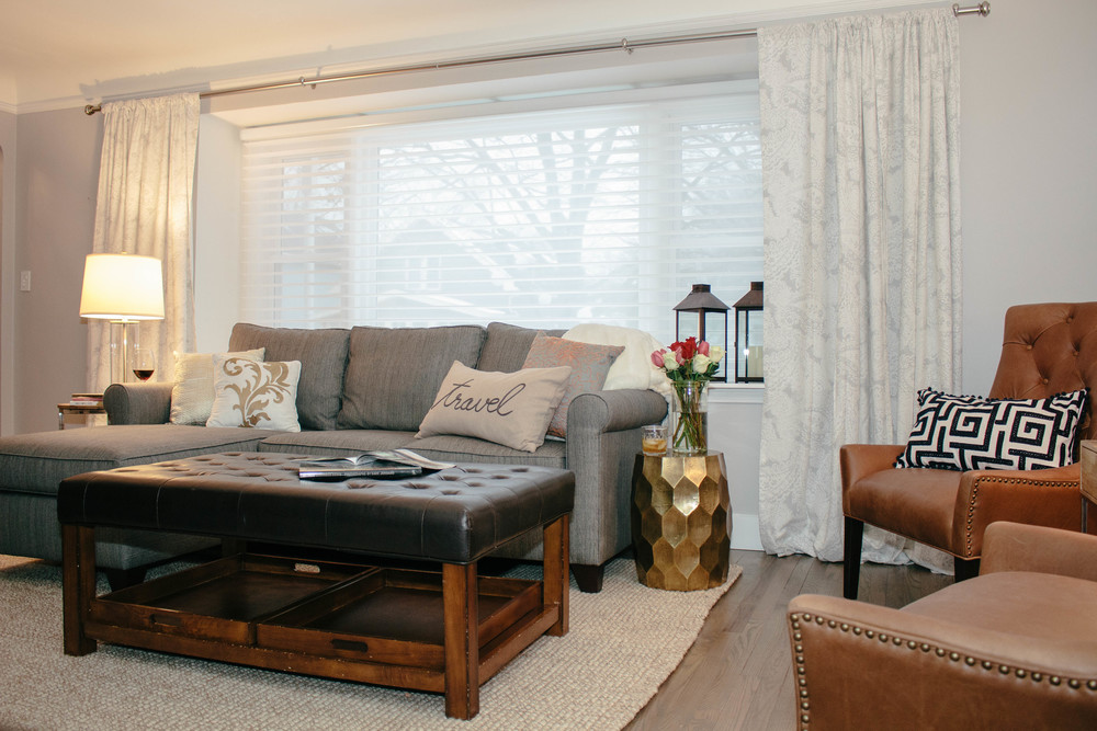living room, family room, pottery barn sofa, pottery barn couch, gold side table, good end table, leather coffee table, neutral rug, lanterns