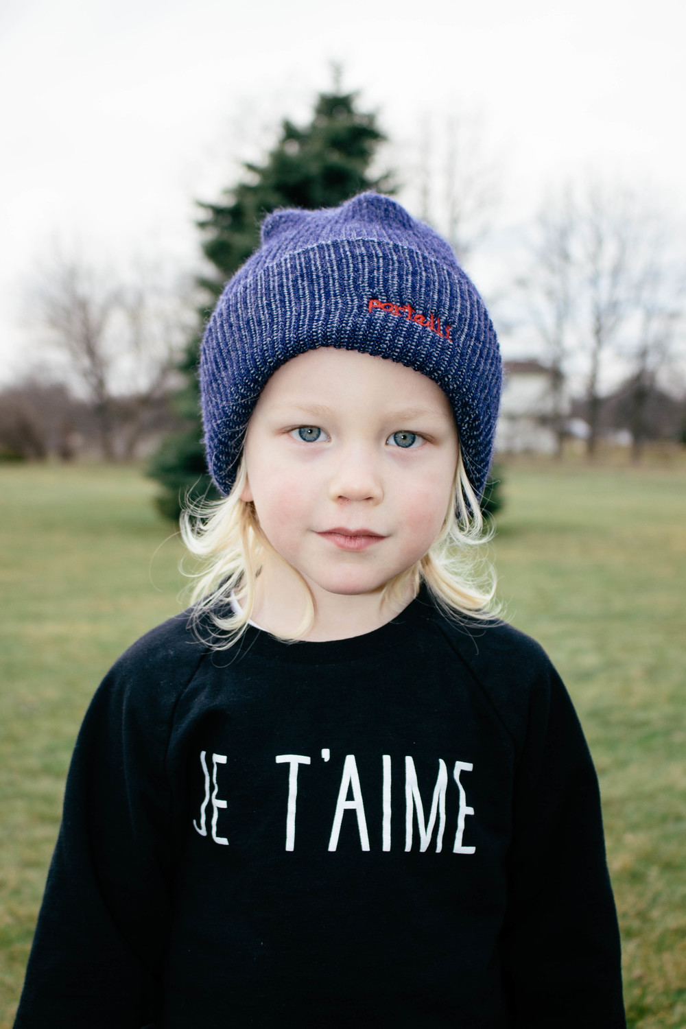 long hair little boy with beanie