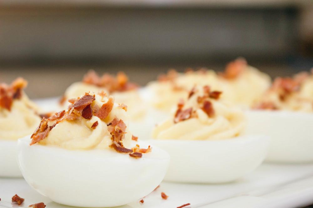 deviled eggs with prosciutto sprinkles, prosciutto, deviled eggs, deviled eggs recipe, how to make deviled eggs, horseradish, not your average deviled eggs, greek yogurt, hard boiled eggs, dijon mustard,