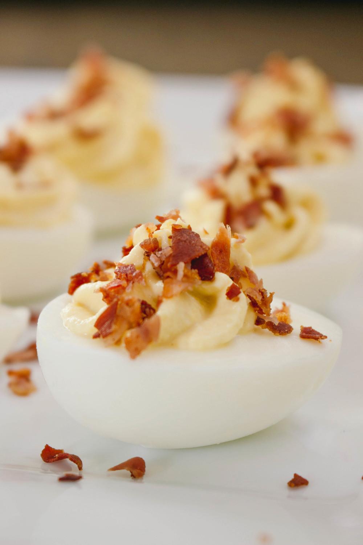 Deviled eggs recipe, deviled eggs with prosciutto sprinkles, prosciutto, deviled eggs, deviled eggs recipe, how to make deviled eggs, horseradish, not your average deviled eggs, greek yogurt, hard boiled eggs, dijon mustard,