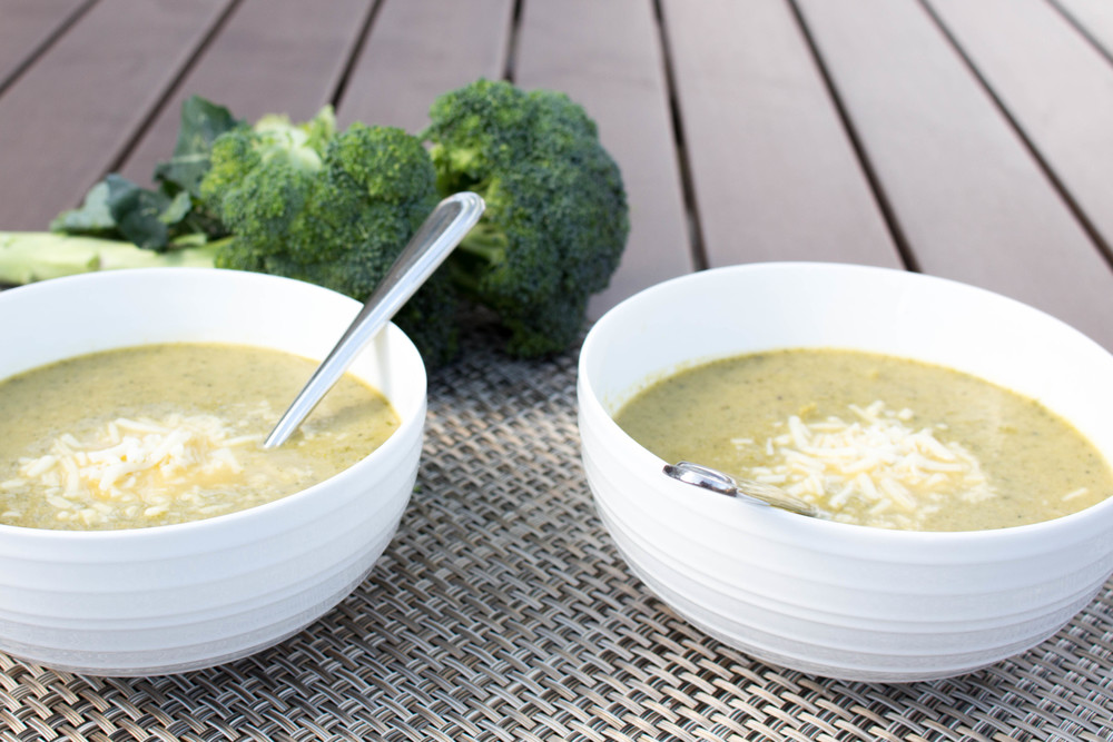 creamy broccoli soup, soup recipe, broccoli soup recipe, broccoli, fresh foods, coconut oil, garlic cloves, arugula, chicken broth, lemon juice, mozzarella cheese, almond milk, almond milk in soup recipe,