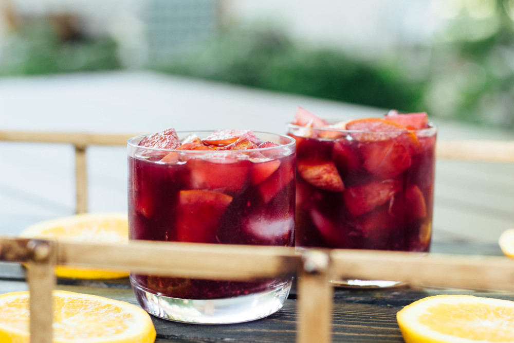 Sangria, drinks, bright summer cocktails, easy cocktails for the summer, how to make sangria's at home, Spanish table wine, oranges, apples, brandy, agave nectar, cinnamon stick, sangria recipe,