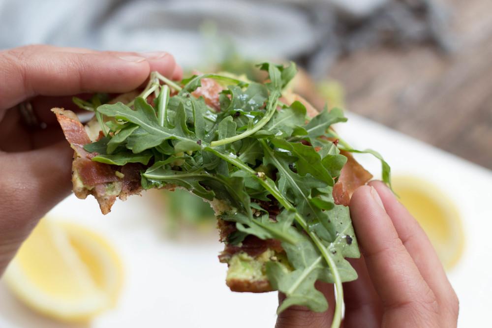 avocado prosciutto arugula sandwiches, how to cook with avocados, avocado, olive oil, red pepper flakes, garlic powder, parmigiano-reggiano cheese, prosciutto, lemon juice,
