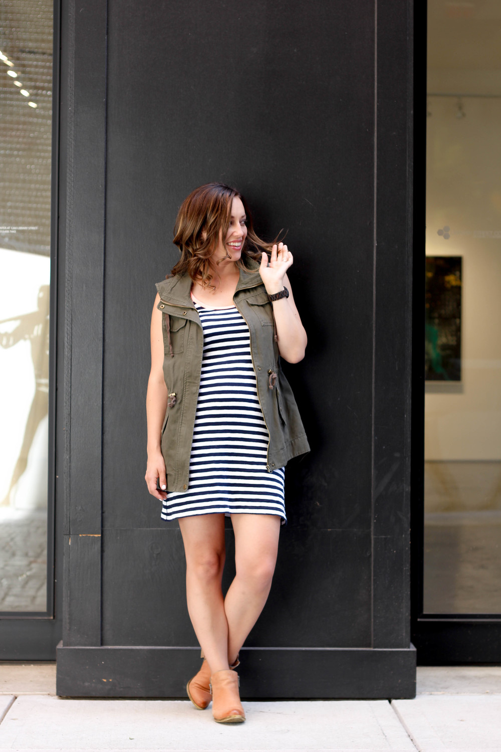 green vest with black and white striped dress and booties outfit
