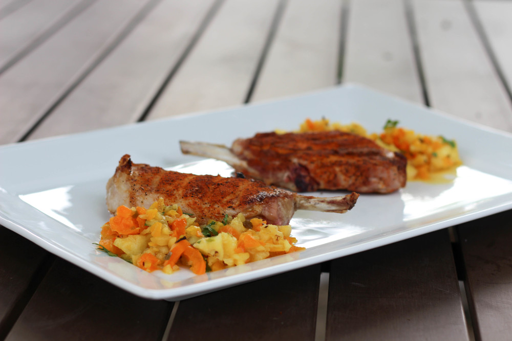 cajun pork chops, pork chop recipe, pineapple salsa, grilled cajun pork chops, summer food, how to make pork chop rub, pineapple, red pepper, orange pepper, jalapeño, cilantro, lime juice,