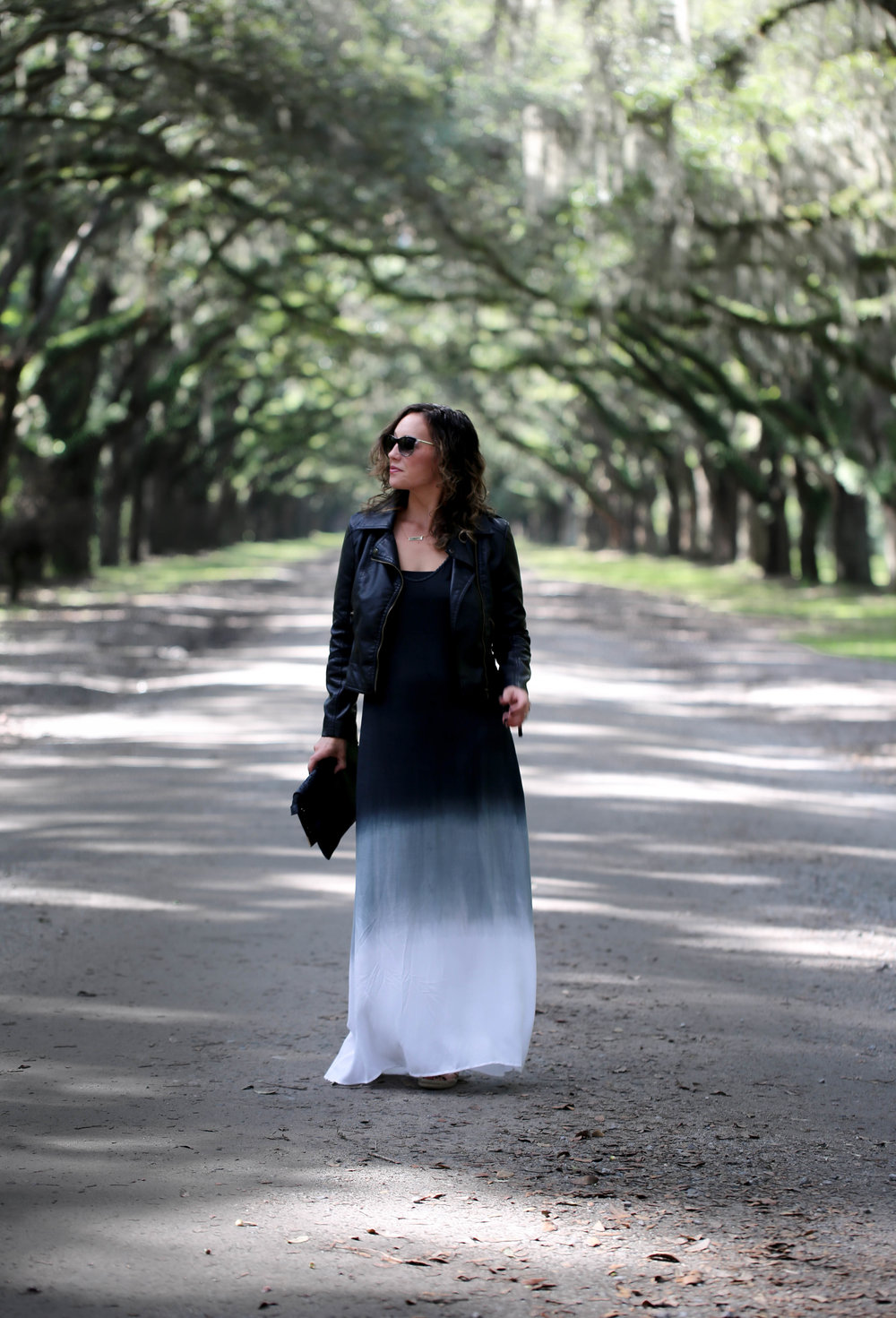 black, white, and gray maxi dress outfit with black leather jacket, how to make your wardrobe work, make the most out of a small closet, living large with a little wardrobe, tie dye maxi dress, maxi dress for women, leather jacket, versatile pieces, how to make your style last longer, getting creative with your clothes,