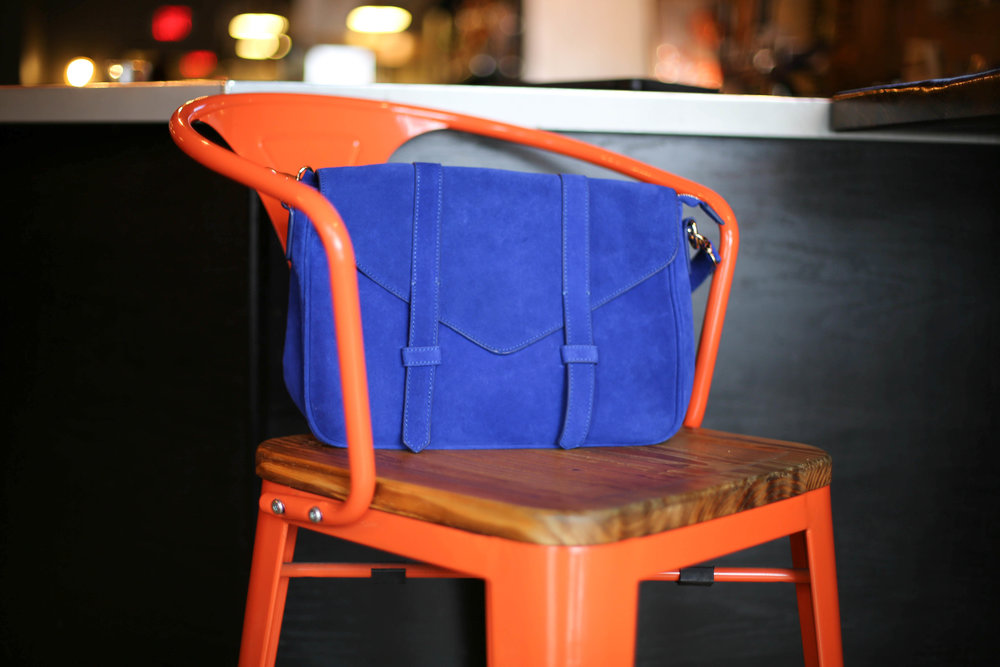 bright orange chair, blue bag, lucy & the wolf, northville michigan, eat local, tapas style,
