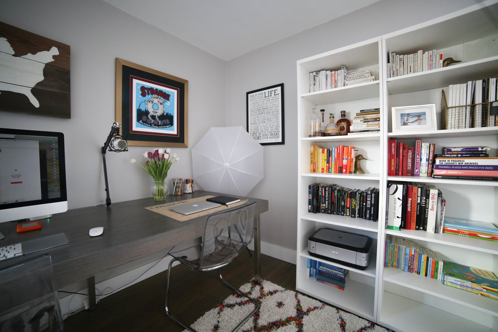 home office, book shelf, color book shelf, rugs usa rug, black door, gold drawers