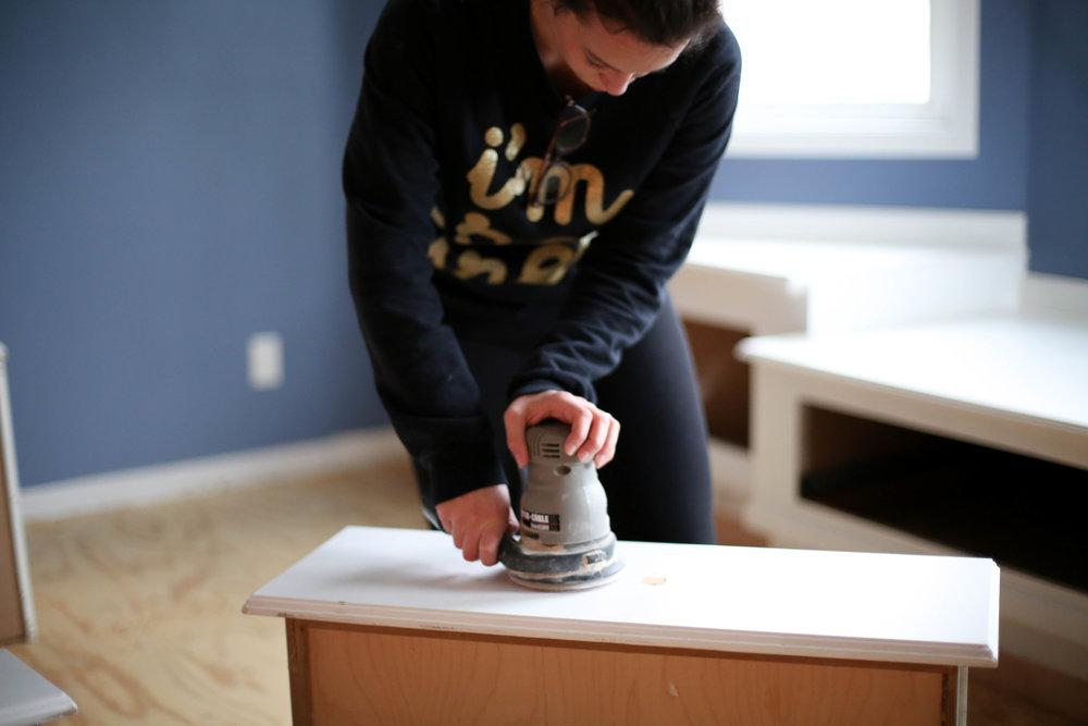 sanding drawers to change hardware size