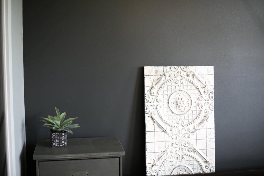black bedroom wall, ceiling tile art work