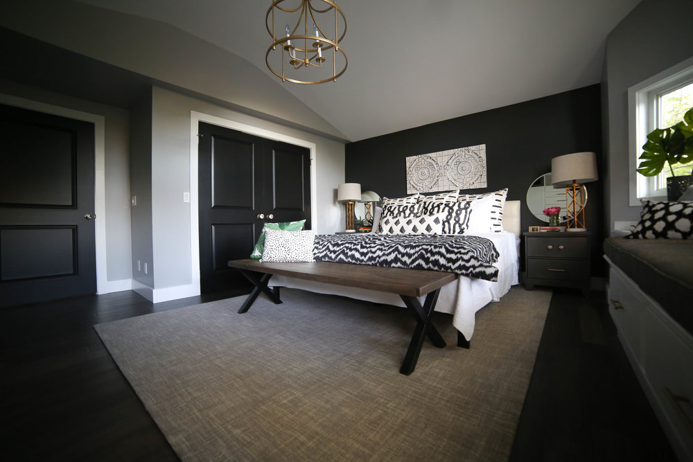 master bedroom, black accent wall, gold chandelier, master bedroom retreat, rustic bedroom, chic bedroom, gold lighting, french gold, black and white bedroom, gray rug, peonies, circle mirrors, black doors